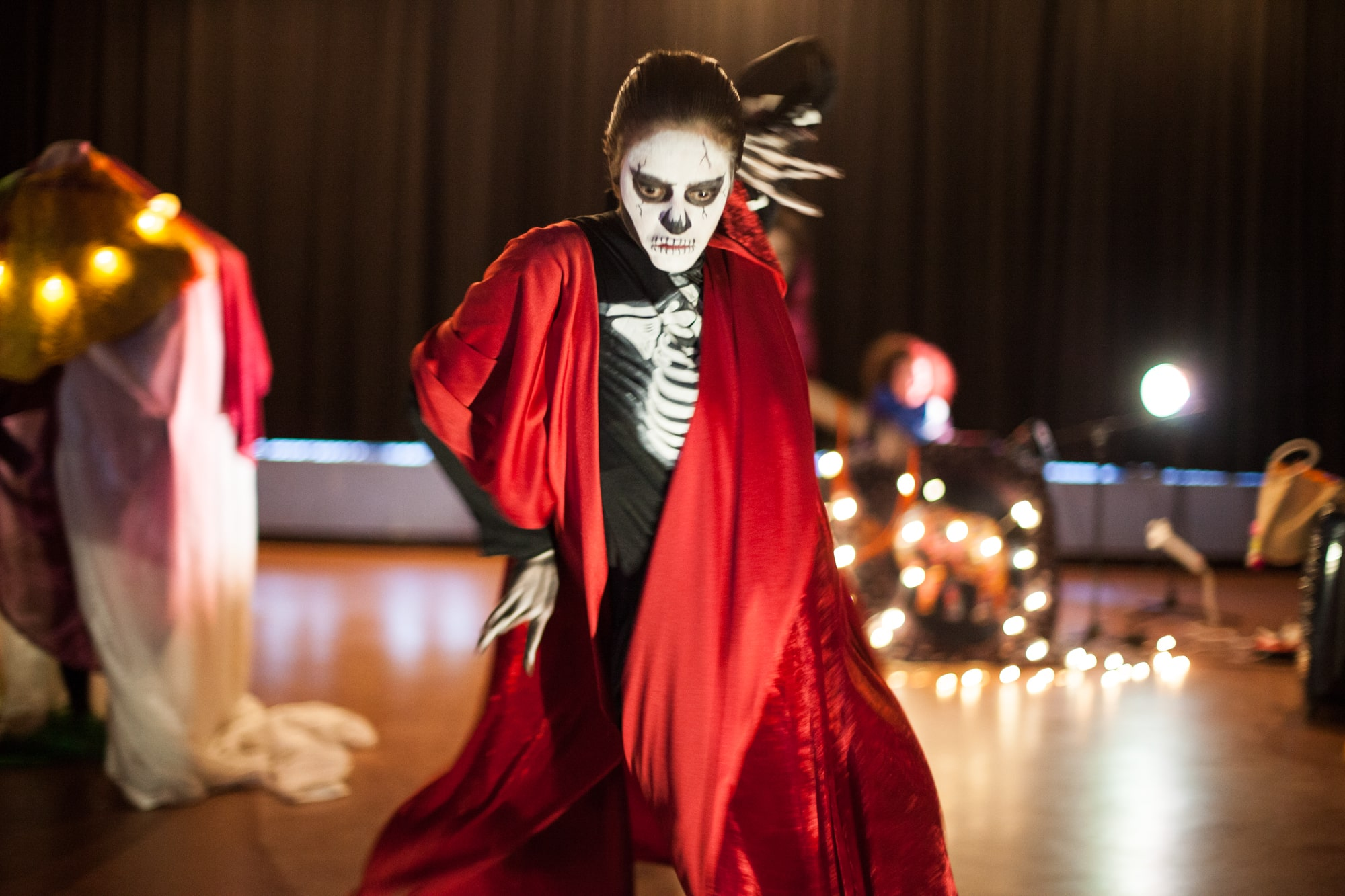 Act Attack theatre class person in skeleton costume performing
