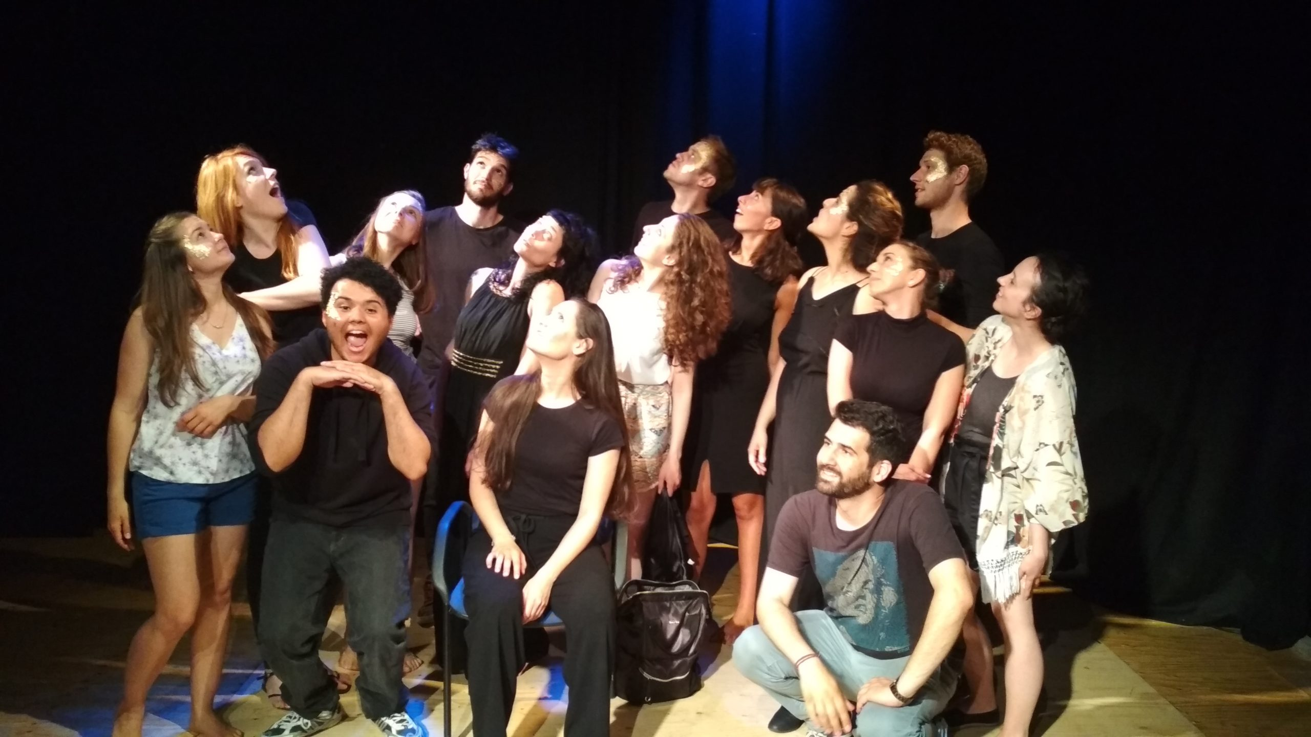 """Keeping up with the Greeks"" show. Group photo of the cast and team, fifteen people. People are posing and looking up"