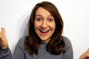 Act Attack teacher Grazyna Frackiewicz. Half-long brown hair, blue eyes, white, laughing, looking surprised